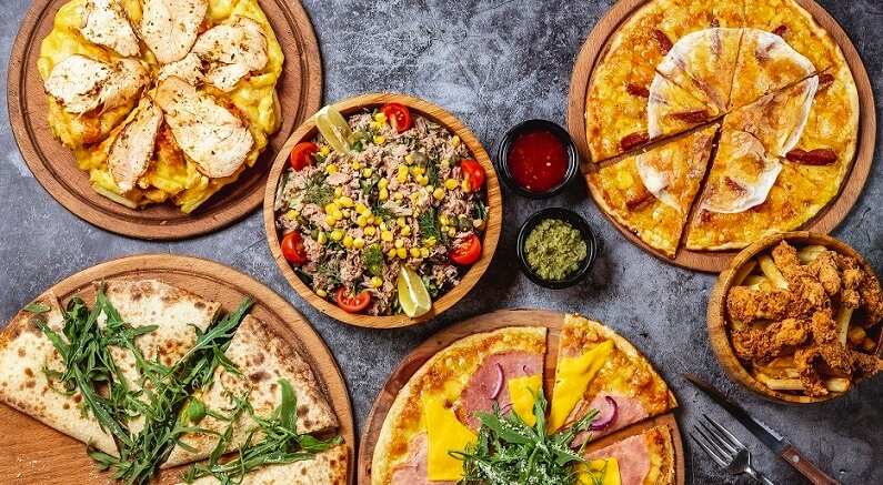 different types of pizza on table