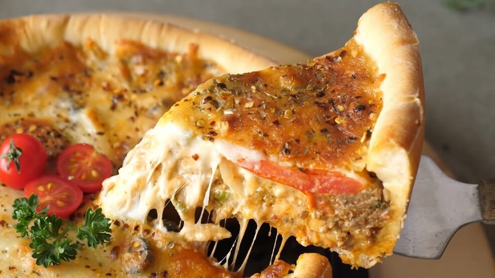 Chicago's Deep-Dish Pizza slice in plate